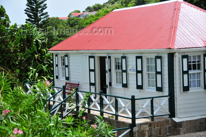 saba29: Windwardside, Saba: the museum - a typical Saban home, whitewashed with green-shuttered windows - displays the dwelling of a XIX century Dutch sea captain - photo by M.Torres - (c) Travel-Images.com - Stock Photography agency - Image Bank
