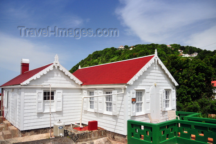 saba38: Windwardside, Saba: in this cottage you can see the pipes that connect the roofs to the underground cistern, allowing rain water to be stored - photo by M.Torres - (c) Travel-Images.com - Stock Photography agency - Image Bank
