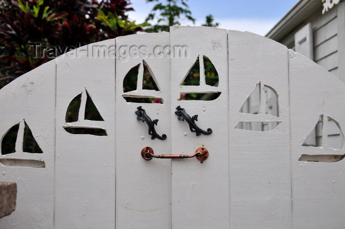saba69: Windwardside, Saba: wooden gate with boats and lizards - Captain's Cottage - Wischusen Family - photo by M.Torres - (c) Travel-Images.com - Stock Photography agency - Image Bank