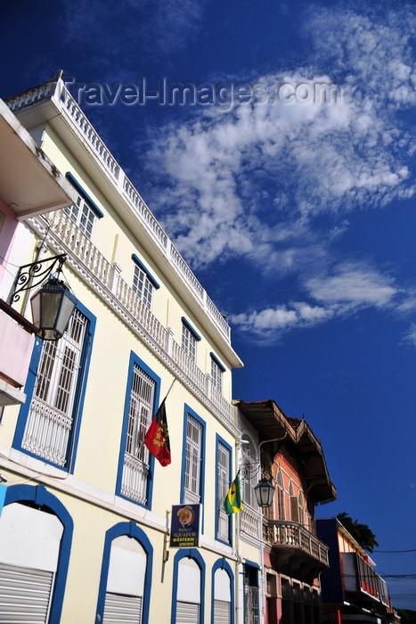 sao-tome262: São Tomé, São Tomé and Príncipe / STP: Equador Bank - Western Union branch - flags of Angola and STP / Banco Equador - Rua de Moçambique - photo by M.Torres - (c) Travel-Images.com - Stock Photography agency - Image Bank