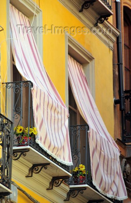 sardinia104: Iglesias /  Igrèsias, Carbonia-Iglesias province, Sardinia / Sardegna / Sardigna: courtains outside the balconies, protecting against the heat - Piazza A.Lamarmora - photo by M.Torres - (c) Travel-Images.com - Stock Photography agency - Image Bank