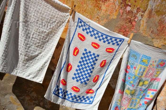 sardinia110: Iglesias /  Igrèsias, Carbonia-Iglesias province, Sardinia / Sardegna / Sardigna: kitchen towels drying outside - photo by M.Torres - (c) Travel-Images.com - Stock Photography agency - Image Bank