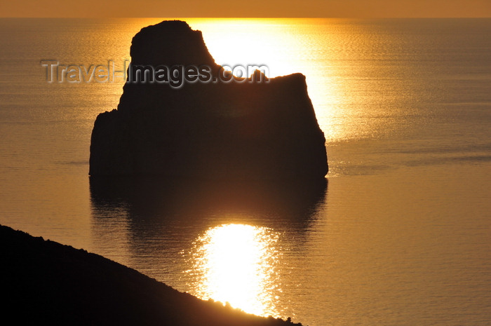 sardinia131: Porto Flavia, Masua, Sardinia / Sardegna / Sardigna: Pan di Zucchero islet at sunset - golden reflection on the Gonnesa gulf - faraglione - photo by M.Torres - (c) Travel-Images.com - Stock Photography agency - Image Bank