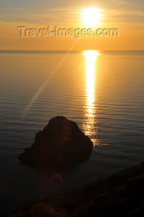 sardinia142: Nebida, Sardinia / Sardegna / Sardigna: sunset on the Gonnesa gulf over the Agosteri rock - limestone stack - Scoglio l'Agosteri - faraglione - photo by M.Torres - (c) Travel-Images.com - Stock Photography agency - Image Bank