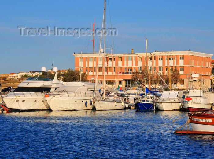 sardinia185: Porto Torres / Pòltu Tòrra, Sassari province, Sardinia / Sardegna / Sardigna: the harbour, built over its Roman predecessor - yachts and Coast Guard building - Cormorano Marina - photo by M.Torres - (c) Travel-Images.com - Stock Photography agency - Image Bank