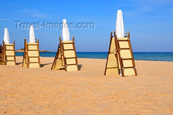 sardinia237: Baia di Chia, Domus de Maria municipality, Cagliari province, Sardinia / Sardegna / Sardigna: beach scene - folded beach chairs and parasols wait for the tourists - photo by M.Torres - (c) Travel-Images.com - Stock Photography agency - Image Bank
