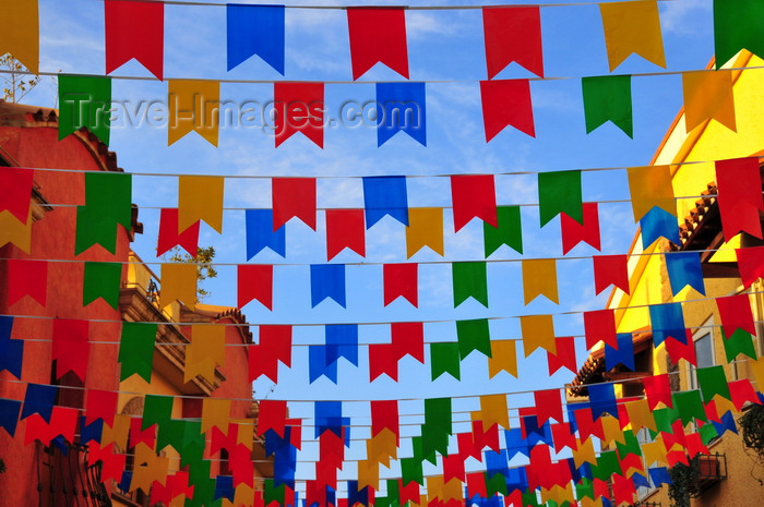 sardinia250: Pula, Cagliari province, Sardinia / Sardegna / Sardigna: street covered in banners - Sant'Efisio celebrations - photo by M.Torres - (c) Travel-Images.com - Stock Photography agency - Image Bank