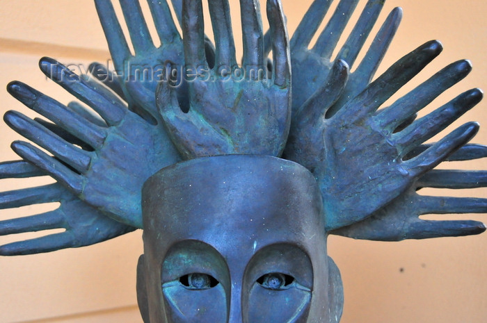 sardinia3: Olbia / Terranoa / Tarranoa, Olbia-Tempio province, Sardinia / Sardegna / Sardigna: modern art at the City Hall - head with a crown of hands - sculpture - photo by M.Torres - (c) Travel-Images.com - Stock Photography agency - Image Bank