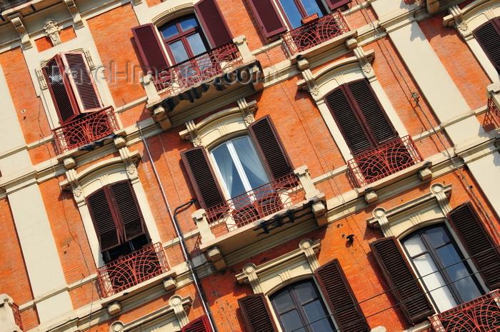 sardinia339: Cagliari, Sardinia / Sardegna / Sardigna: Art Nouveau balcony railings and the French shutters of palazzo Leone Manca - Via Roma - quartiere Marina - photo by M.Torres - (c) Travel-Images.com - Stock Photography agency - Image Bank