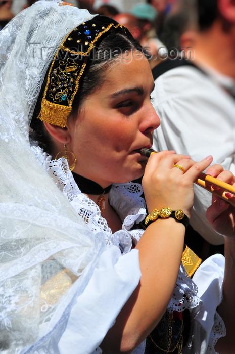 sardinia384: Cagliari, Sardinia / Sardegna / Sardigna: Feast of Sant'Efisio / Sagra di Sant'Efisio - piper - woman playing launeddas - photo by M.Torres - (c) Travel-Images.com - Stock Photography agency - Image Bank