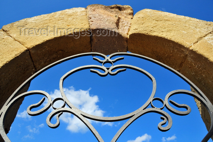 sardinia87: Barumini , Medio Campidano province, Sardinia / Sardegna / Sardigna: Church of the Immaculate Conception - arch and gate detail - an heart or a tomatoe, depending on the beholder - photo by M.Torres - (c) Travel-Images.com - Stock Photography agency - Image Bank
