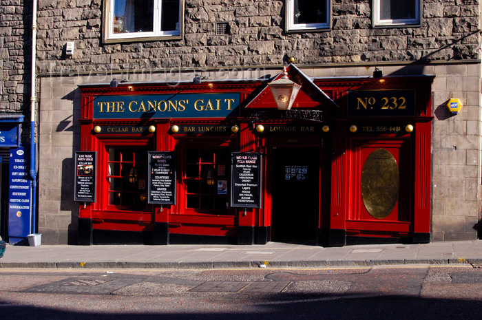 scot127: Scotland - Edinburgh: this clever sign is a takeoff on the nearby street Canongate - vibrant colors in the storefront - 'The Canon's Gait' - photo by C.McEachern - (c) Travel-Images.com - Stock Photography agency - Image Bank