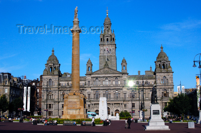 scot151: Scotland - Glasgow - George Squarein Glasgow - Robert Burns statue, nearest, the Sir Walter Scott column,and the City Chambers in the background with the sun reflecting in one of its windows - photo by C.McEachern - (c) Travel-Images.com - Stock Photography agency - Image Bank