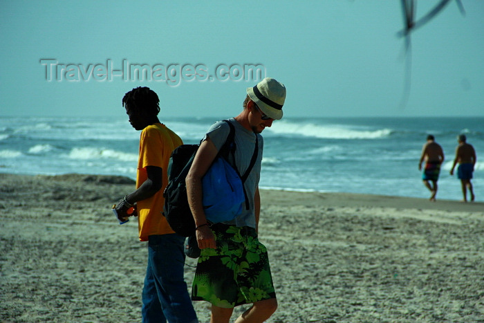 senegal114: Cap Skirring, Oussouye, Basse Casamance (Ziguinchor), Senegal: men Walking, everyday life / Homem caminhando na praia, vida quotidiana - photo by R.V.Lopes - (c) Travel-Images.com - Stock Photography agency - Image Bank