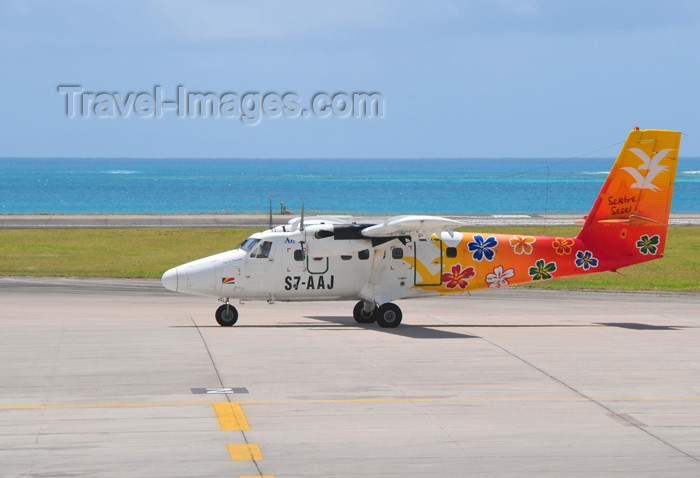 seychelles152: Mahe, Seychelles: Air Seychelles De Havilland Canada DHC-6-300 Twin Otter S7-AAJ (cn 499) Isle of Desroches with hibiscus flowers livery - Seychelles International Airport - SEZ - photo by M.Torres - (c) Travel-Images.com - Stock Photography agency - Image Bank