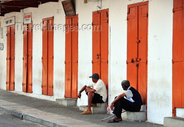 seychelles76: Mahe, Seychelles: idle time on Market street - men and red doors - photo by M.Torres - (c) Travel-Images.com - Stock Photography agency - Image Bank