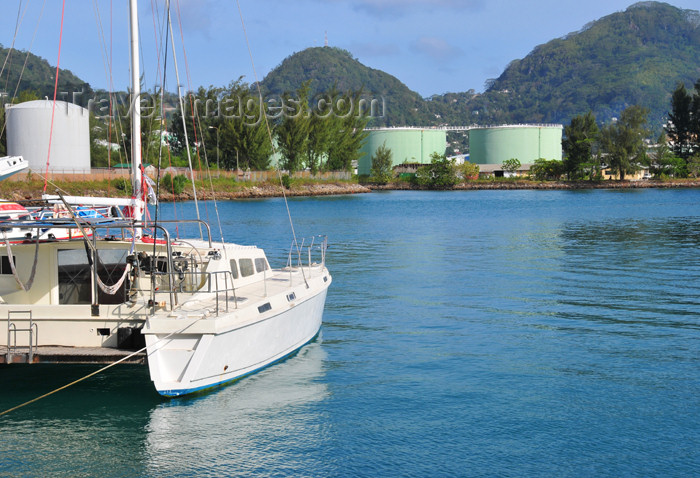 seychelles90: Mahe, Seychelles: Victoria - in the port - catamaran and fuel storage - photo by M.Torres - (c) Travel-Images.com - Stock Photography agency - Image Bank