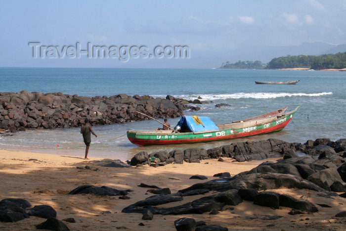 sierra-leone5: Kent, Sierra Leone: fishing boat in rocks blue sea and sky - photo by J.Britt-Green - (c) Travel-Images.com - Stock Photography agency - Image Bank