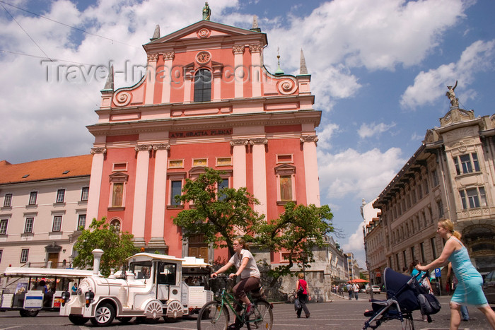 slovenia102: Franciscan church of the Annunciation and Presernov trg  - people and tourist train, Ljubljana, Slovenia - photo by I.Middleton - (c) Travel-Images.com - Stock Photography agency - Image Bank