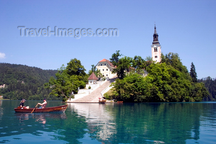 slovenia164: Slovenia - Couple rowing past church of the Assumption on Lake Bled - photo by I.Middleton - (c) Travel-Images.com - Stock Photography agency - Image Bank