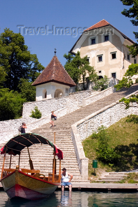 slovenia165: Slovenia - Pletna boat moored at the steps to the church of the Assumption on lake bled - photo by I.Middleton - (c) Travel-Images.com - Stock Photography agency - Image Bank