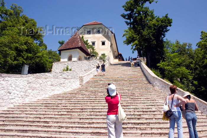 slovenia166: Slovenia - Tourists looking up the 99 steps to the church of the Assumption on Lake Bled - photo by I.Middleton - (c) Travel-Images.com - Stock Photography agency - Image Bank