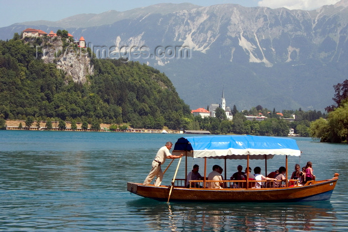 slovenia168: Slovenia - Pletna rowing tourists on lake Bled - photo by I.Middleton - (c) Travel-Images.com - Stock Photography agency - Image Bank