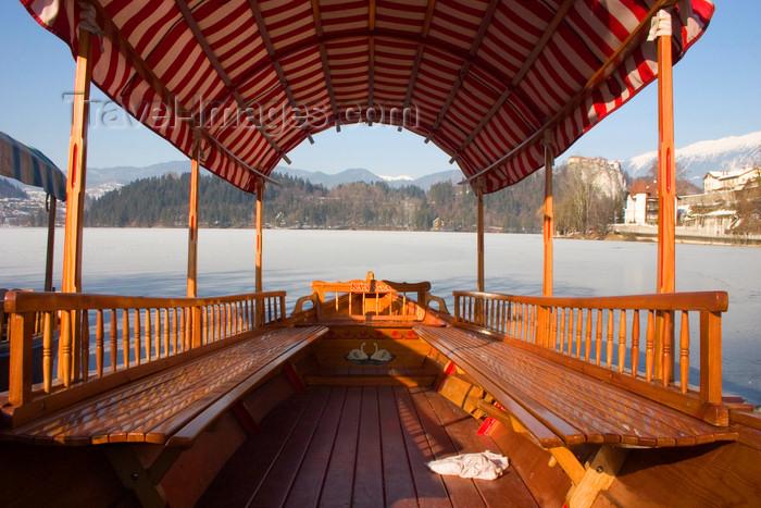 slovenia178: Slovenia - Pletna moored at Lake Bled - winter - frozen lake - Upper Carniola / Gorenjska region - Pokljuka plateau - photo by I.Middleton - (c) Travel-Images.com - Stock Photography agency - Image Bank
