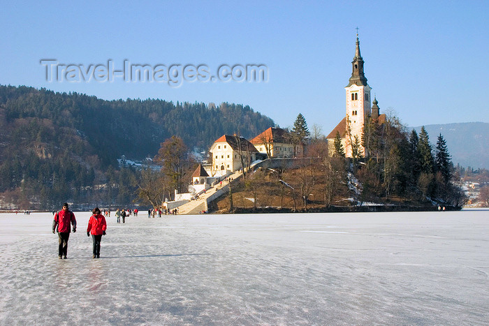 slovenia181: Slovenia - people walking across ice - island church on Lake Bled in Slovenia when frozen over in winter - photo by I.Middleton - (c) Travel-Images.com - Stock Photography agency - Image Bank