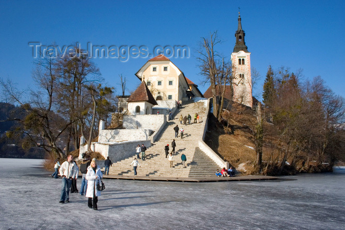 slovenia182: Slovenia - View across to the island church on Lake Bled in Slovenia when frozen over in winter with people walking across ice - photo by I.Middleton - (c) Travel-Images.com - Stock Photography agency - Image Bank