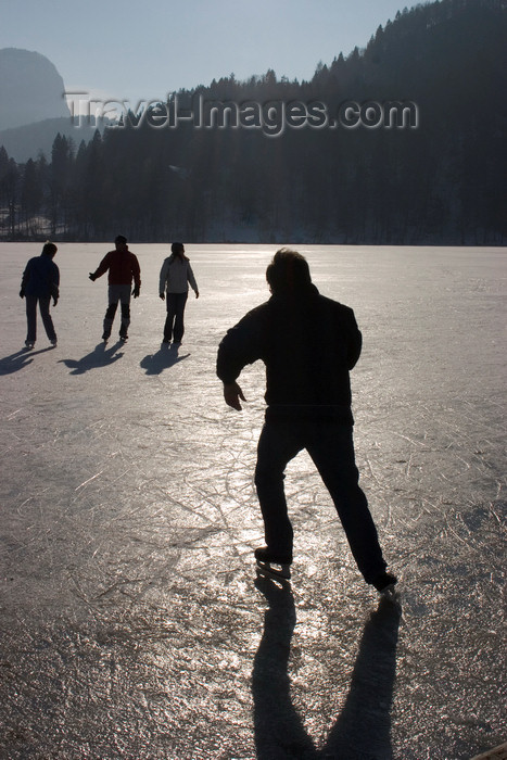 slovenia183: Slovenia - People ice skating across Lake Bled when frozen over in winter - photo by I.Middleton - (c) Travel-Images.com - Stock Photography agency - Image Bank