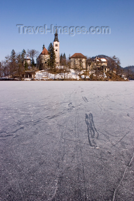 slovenia186: Slovenia - tracks on the ice - frozen lake Bled and the island church of the Assumption of Mary - Cerkev Marijinega vnebovzetja - photo by I.Middleton - (c) Travel-Images.com - Stock Photography agency - Image Bank
