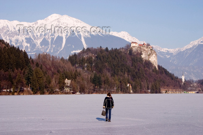 slovenia187: Slovenia - a woman walks across Lake Bled when frozen over in winter - photo by I.Middleton - (c) Travel-Images.com - Stock Photography agency - Image Bank