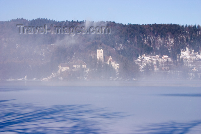 slovenia188: Slovenia - mist - view across to the island church on Lake Bled when frozen over in winter - photo by I.Middleton - (c) Travel-Images.com - Stock Photography agency - Image Bank