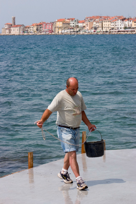 slovenia295: Slovenia - Piran: getting a bucket of sea water - photo by I.Middleton - (c) Travel-Images.com - Stock Photography agency - Image Bank