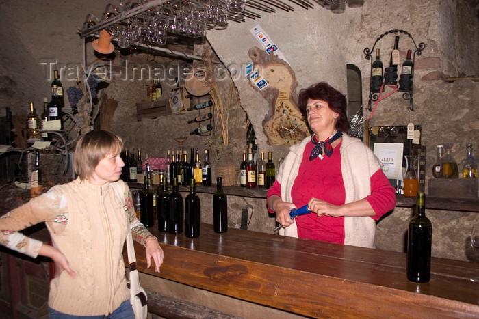 slovenia318: Slovenia - Bizeljsko: Owner behind bar in Oresje Castle vinoteka - photo by I.Middleton - (c) Travel-Images.com - Stock Photography agency - Image Bank