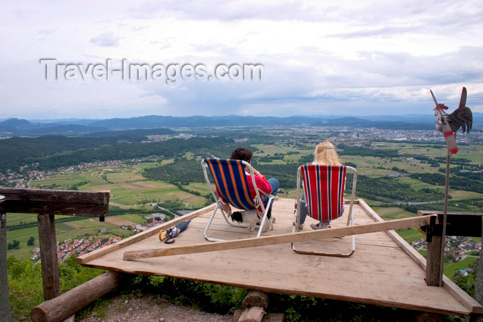 slovenia39: deck chairs - a couple enjoys the view towards the Kamnik Mountains - Smarna Gora mountain on the outskirts of Ljubljana, Slovenia - photo by I.Middleton - (c) Travel-Images.com - Stock Photography agency - Image Bank