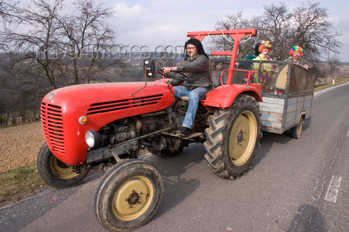 slovenia507: tractor in a Pust parade - a traditional celebration where people dress up to scare off the winter - Fokovci, Prekmurje, Slovenia - photo by I.Middleton - (c) Travel-Images.com - Stock Photography agency - Image Bank