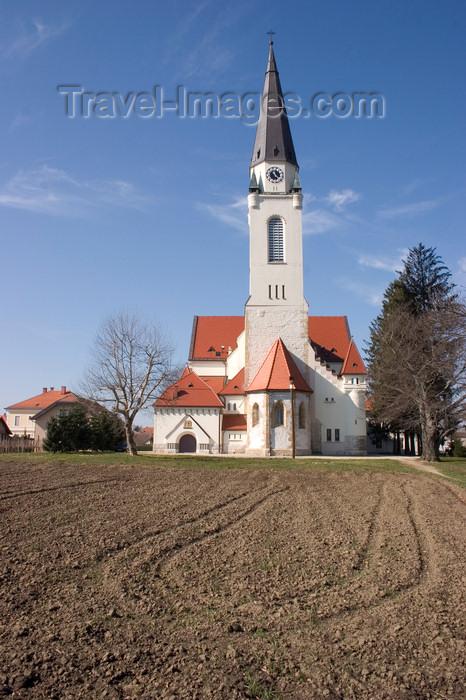 slovenia510: field and Church of Saint Nicholas in Murska Sobota, Prekmurje, Slovenia - photo by I.Middleton - (c) Travel-Images.com - Stock Photography agency - Image Bank