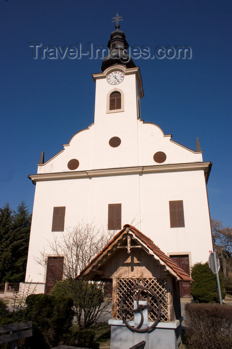 slovenia515: water pump and Lutheran church - Bodonci, Puconci municipality, Prekmurje, Slovenia - photo by I.Middleton - (c) Travel-Images.com - Stock Photography agency - Image Bank