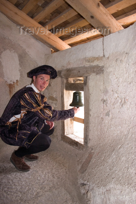 slovenia531: Tour guide ringing wishing bell of Predjama Castle , Slovenia - photo by I.Middleton - (c) Travel-Images.com - Stock Photography agency - Image Bank