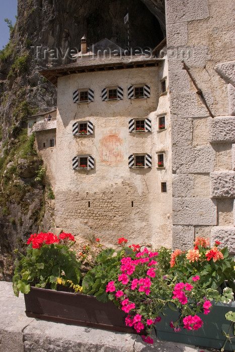 slovenia534: Predjama castle - Predjamski Grad - flower pots, Slovenia - photo by I.Middleton - (c) Travel-Images.com - Stock Photography agency - Image Bank