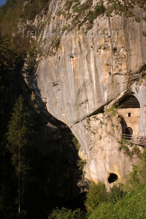 slovenia539: Cave entrance and valley underneath Predjama castle , Slovenia - photo by I.Middleton - (c) Travel-Images.com - Stock Photography agency - Image Bank