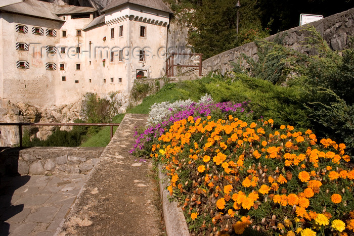 slovenia550: Predjama castle - flowers, Slovenia - photo by I.Middleton - (c) Travel-Images.com - Stock Photography agency - Image Bank