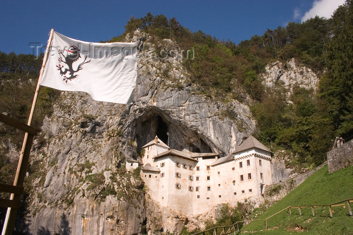 slovenia551: Predjama castle - flag, Slovenia - photo by I.Middleton - (c) Travel-Images.com - Stock Photography agency - Image Bank