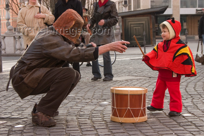 slovenia716: Slovenia - Ljubliana: Pust celebrations - drummer and monster - photo by I.Middleton - (c) Travel-Images.com - Stock Photography agency - Image Bank