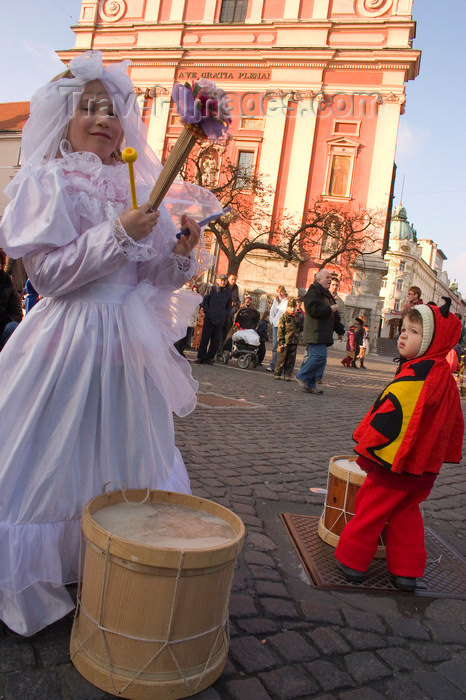 slovenia718: Slovenia - Ljubliana: Pust celebrations - fairy and the Franciscan church - photo by I.Middleton - (c) Travel-Images.com - Stock Photography agency - Image Bank