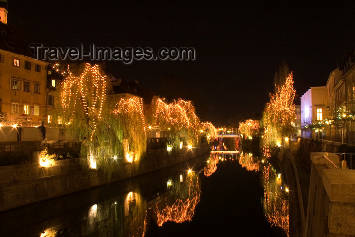 slovenia74: Christmas illuminations reflected on the river Ljubljanica, Ljubljana , Slovenia - photo by I.Middleton - (c) Travel-Images.com - Stock Photography agency - Image Bank