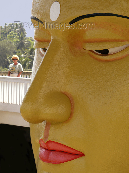 sri-lanka54: Matara, Southern province, Sri Lanka: temple - Buddha face close-up with tourist - photo by B.Cain - (c) Travel-Images.com - Stock Photography agency - Image Bank