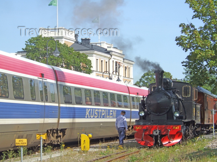 sweden104: Vastervik, Kalmar län, Sweden: Steam and Diesel Trains by he station - old and new - photo by A.Bartel - (c) Travel-Images.com - Stock Photography agency - Image Bank